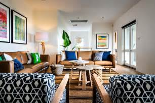 brown leather sofa living room midcentury with black patterned chair blue beeyoutifullife com