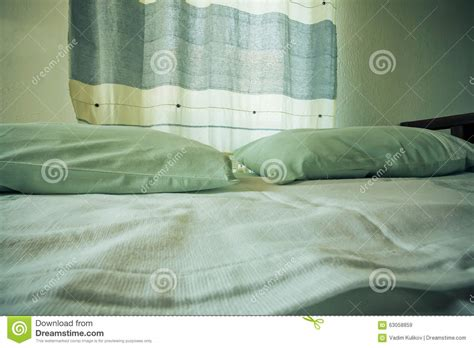two pillows on bed stock photo image of domestic room selective focus on pillows and curtain of a small cozy