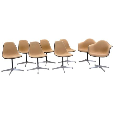 Set Of Eight Upholstered Eames Swivel Dining Chairs Two Upholstered Swivel Dining Chairs