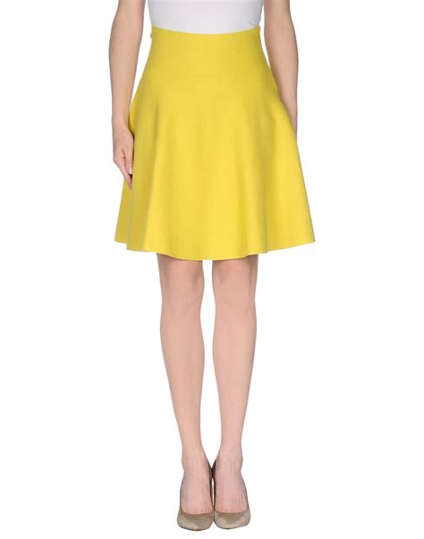 212 new york knee length skirt in yellow lyst