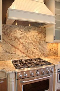 the kitchen collection inc polished brown quartzite kitchen counters and height backsplash considered a