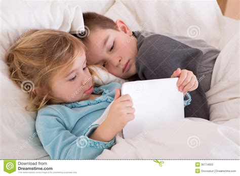 Boys Bedtime Stories and boy reading a bedtime story stock