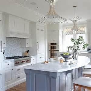 Curved Kitchen Islands this beautiful kitchen features a blue kitchen island with curved
