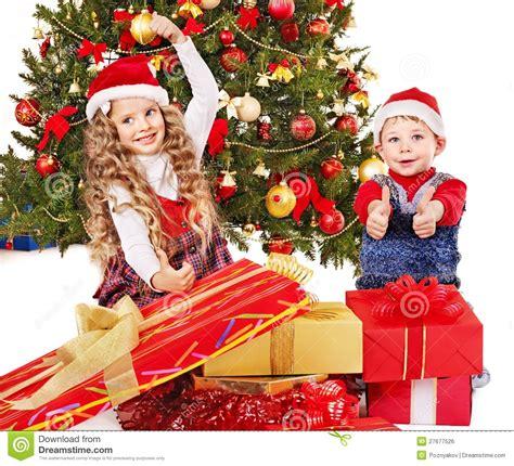 child and petprof xmas tree children with gift box near tree stock photo image 27677526