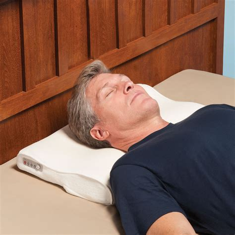 Nudging Pillow by The Snore Activated Nudging Pillow Hammacher Schlemmer