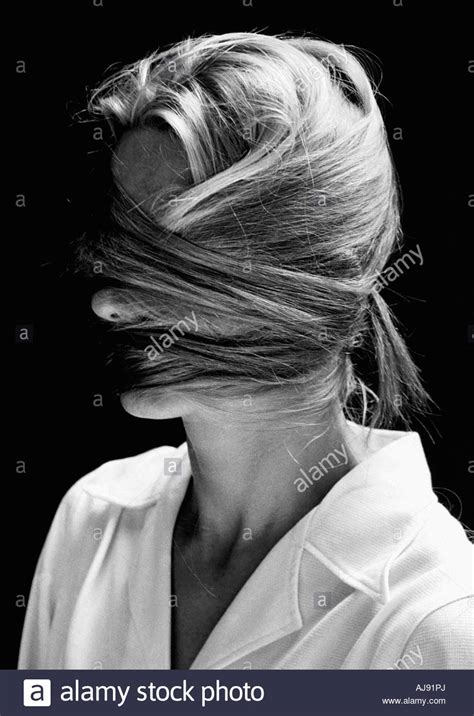 wrapped image of long hair woman with hair wrapped around her face stock photo