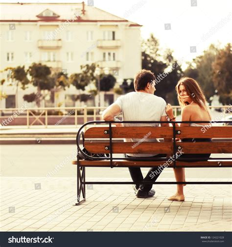couple on park bench young couple sitting on bench park stock photo 124221028