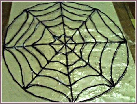 spider web pattern paper how to make a halloween spider web door hanger