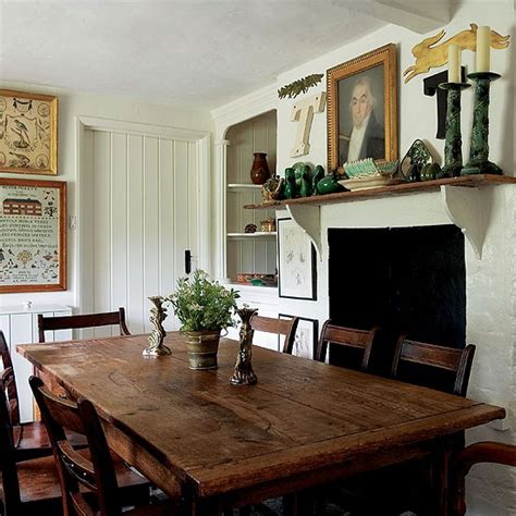 dining table in front of fireplace country cottage kitchen kitchen diner design