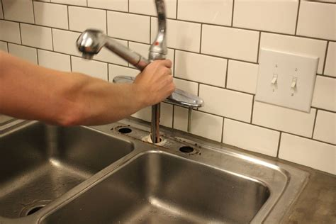 remove kitchen sink faucet how to upgrade and install your kitchen faucet