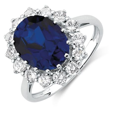 ring with created blue created white sapphires in