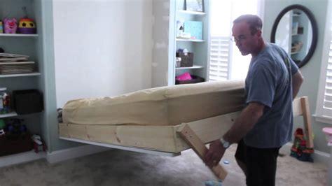 diy wall bed    bed    shelves