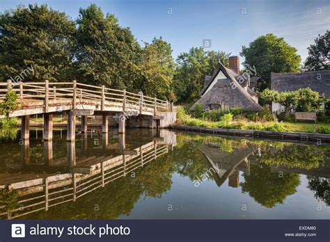 Flatford Bridge Cottage by Flatford Bridge And Bridge Cottage On The River Stour In