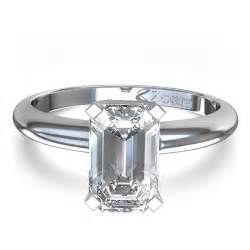 Delicate emerald cut diamond engagement ring in 14k white gold