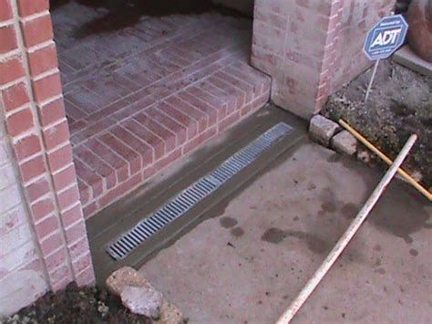 Drain In Front Of Garage Door by Channel Drain Installed By Cmg Lawns And Plants And