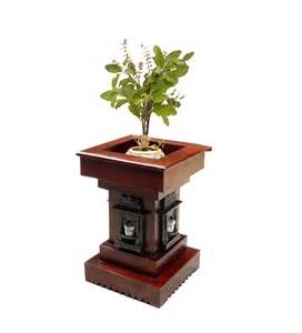 saffron carved tulsi planter by mudra pots