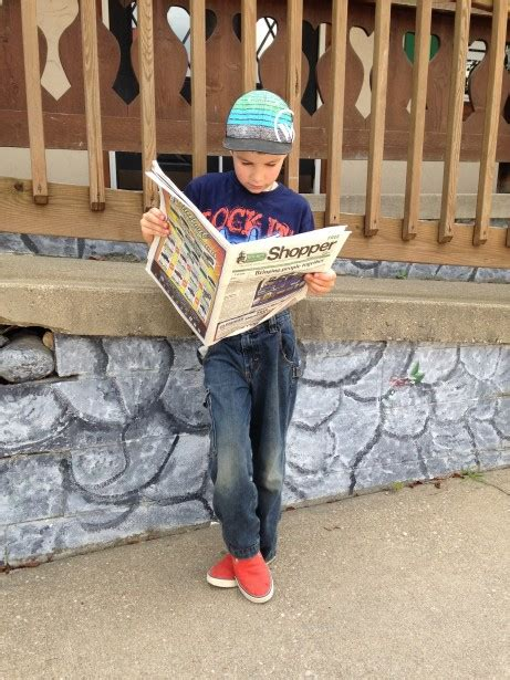 boy reading newspaper  stock photo public domain pictures