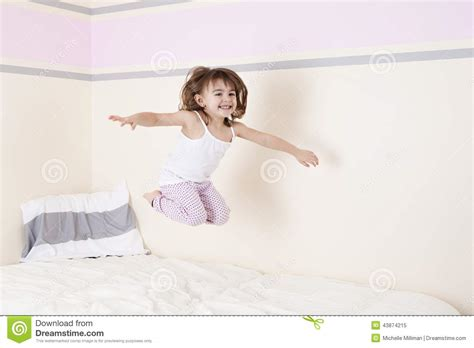 jumping on the bed stock photo image 43874215