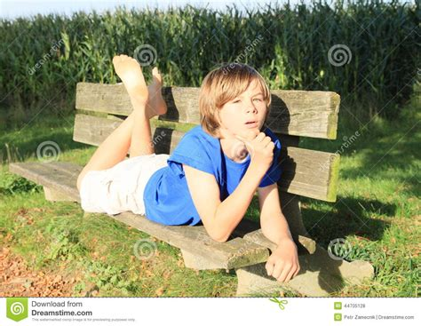 kid on bench little kid boy on a bench stock photo image 44705128