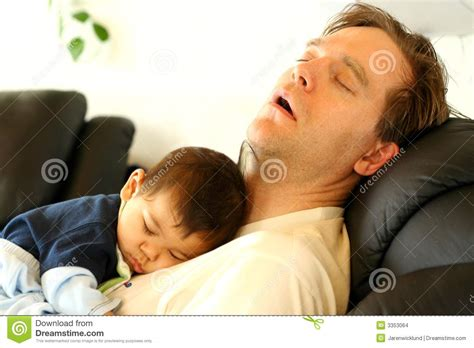 sleeping with baby in recliner baby sleeping on dad s chest stock images image 3353064