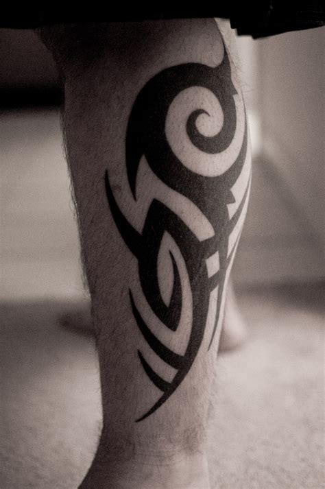 tribal leg tattoo designs for men