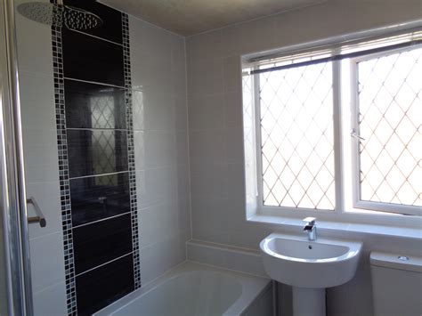 bathroom tile feature ideas coventry bathrooms 187 refitted bathroom with white tiles