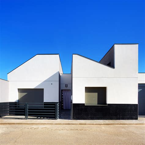 architects and designers houses dezeen ooiio architecture s casa arm appears cut in half by a