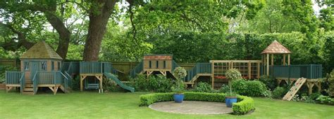 Treehouse with rope bridge tunnel and shelter treehouses the playhouse company