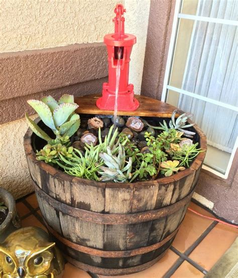 wine barrel planter ideas 17 best ideas about wine barrel planter on wine barrel garden whiskey barrel