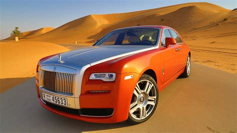 roll royce orange rolls royce ghost test drive at the empty quarter