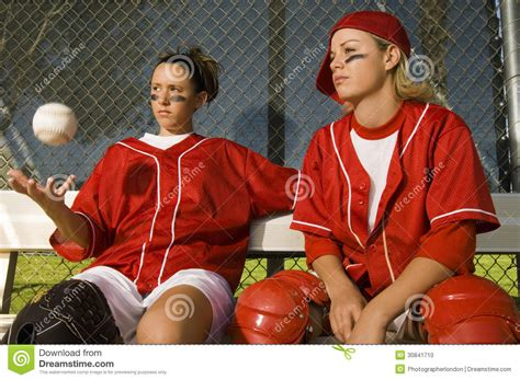 players on the bench softball players sitting on bench stock photo image 30841710