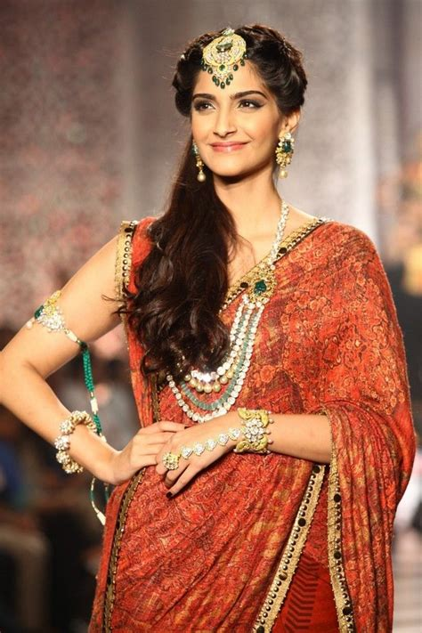 hairstyles with indian outfits sonam kapoor looked stunning in a maang tika and a heavy