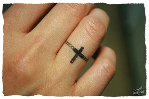 cross ring tattoos i m totally getting something like this someday it ll