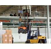 Closely Supervised Use Of Two Forklifts To Lift Factory Equipment A