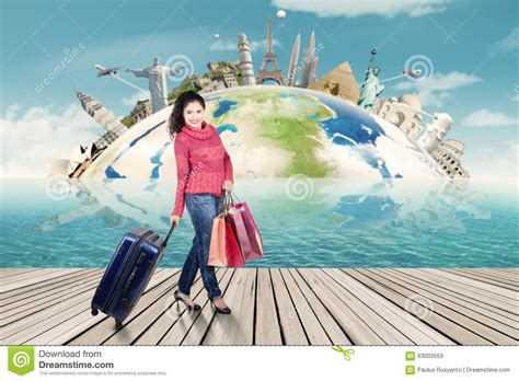 Around The World For Free in winter clothes traveling around the world stock