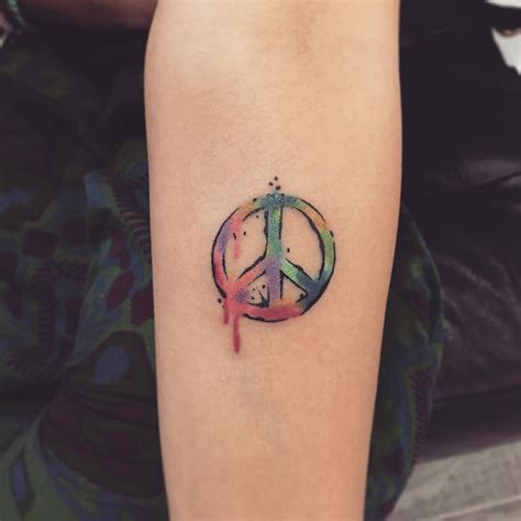 small peace tattoo 55 best peace sign designs anti war movement