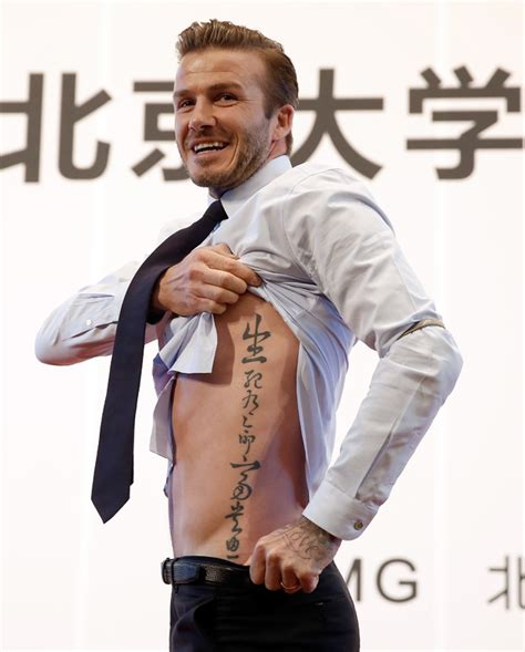 david beckham unveils chinese torso tattoo showbiz news