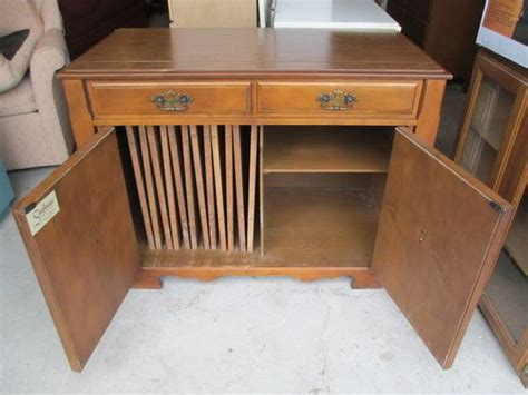 I Am Looking To Purchase A Saginaw Expando Table In Cabinet With Leaves Tha My Antique