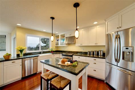 white kitchen cabinets with cherry wood floors wood floors