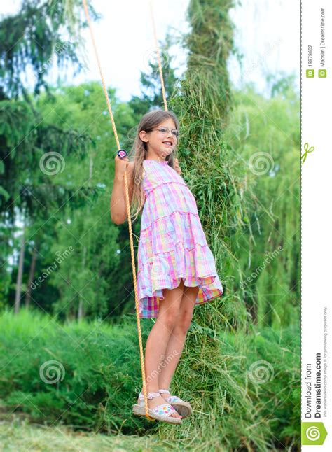 girl on swing young girl on swing stock photography image 19879662