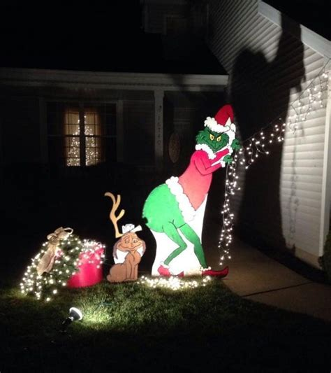 grinch pulling down lights grinch yard decorations pulling our lights he s 6 1 2 ft i drew him