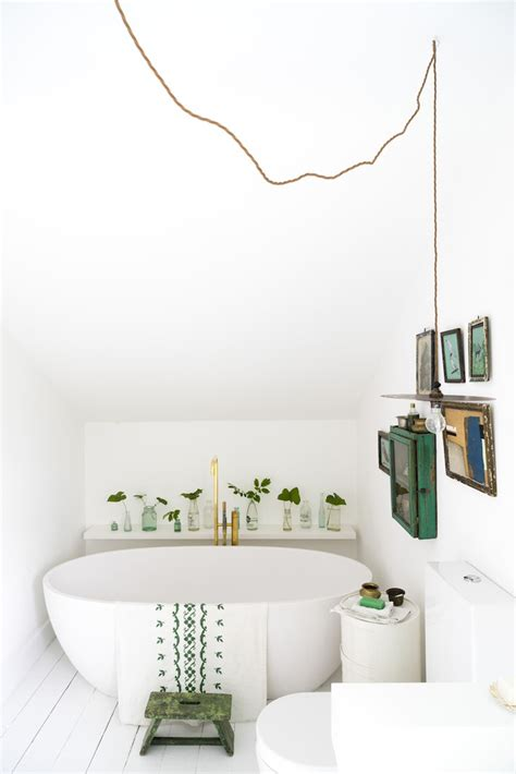 White Bathroom With Color Accents by These Small Bathrooms Will Give You Remodeling Ideas
