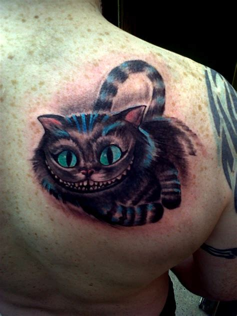 cat tattoo hours cheshire cat by nirpa on deviantart