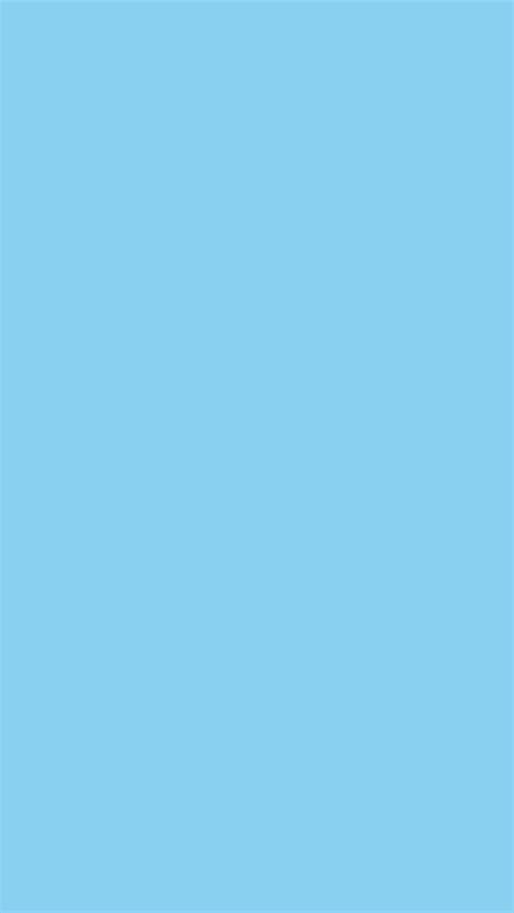 baby blue solid color background face shots