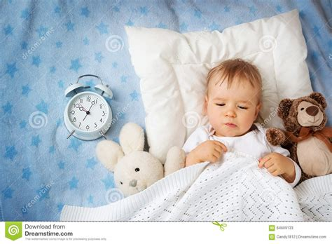 one year old bed one year old baby with alarm clock stock photo image 64609133