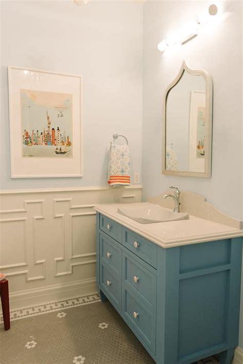 blue bathroom vanity with grey mirror