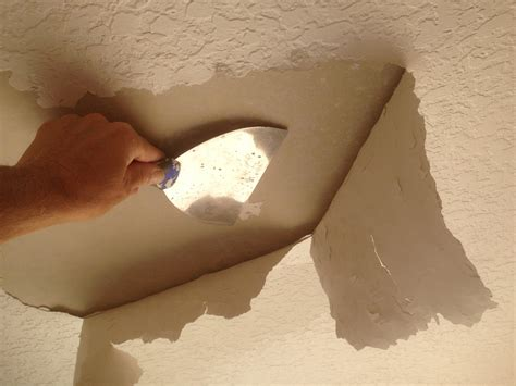 how to remove textured paint from ceiling ceiling bubbling while painting a knockdown textured