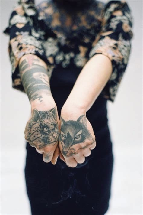 cat tattoo in hand perfect hand tattoo 2 wolf hand tattoo on tattoochief com