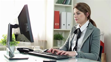 office work images young businesswoman working on computer in the office hd
