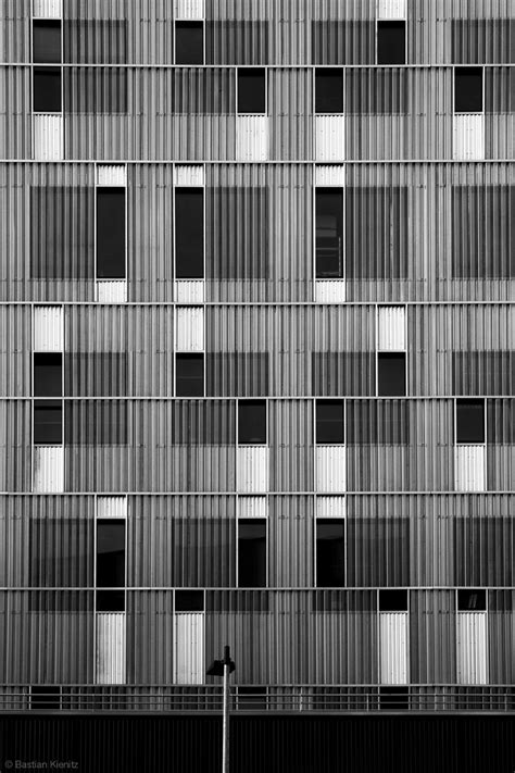 irregular grid patterns  architecture  contrasting lines tone texture facades